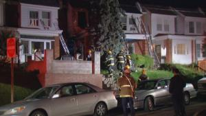 Firefighters controll a fire at 500 Geneva Avenue. A man and his dog are hospitalized after a fire in his home. The man, recuperating at Einstein Medical Center, lost one dog from complications from the fire. (Photo courtesy of NBC 10)