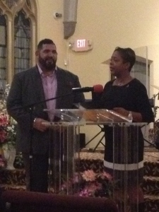 Councilwoman Bass gives an award to Pastor Alex of Oasis City Church in Olney.